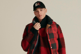 A model inTommy Hilfiger Fall 2020 Collection Red and Black puffer jacket
