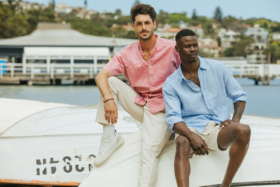 Two models in UNIQLO Linen shirts and pants/shorts