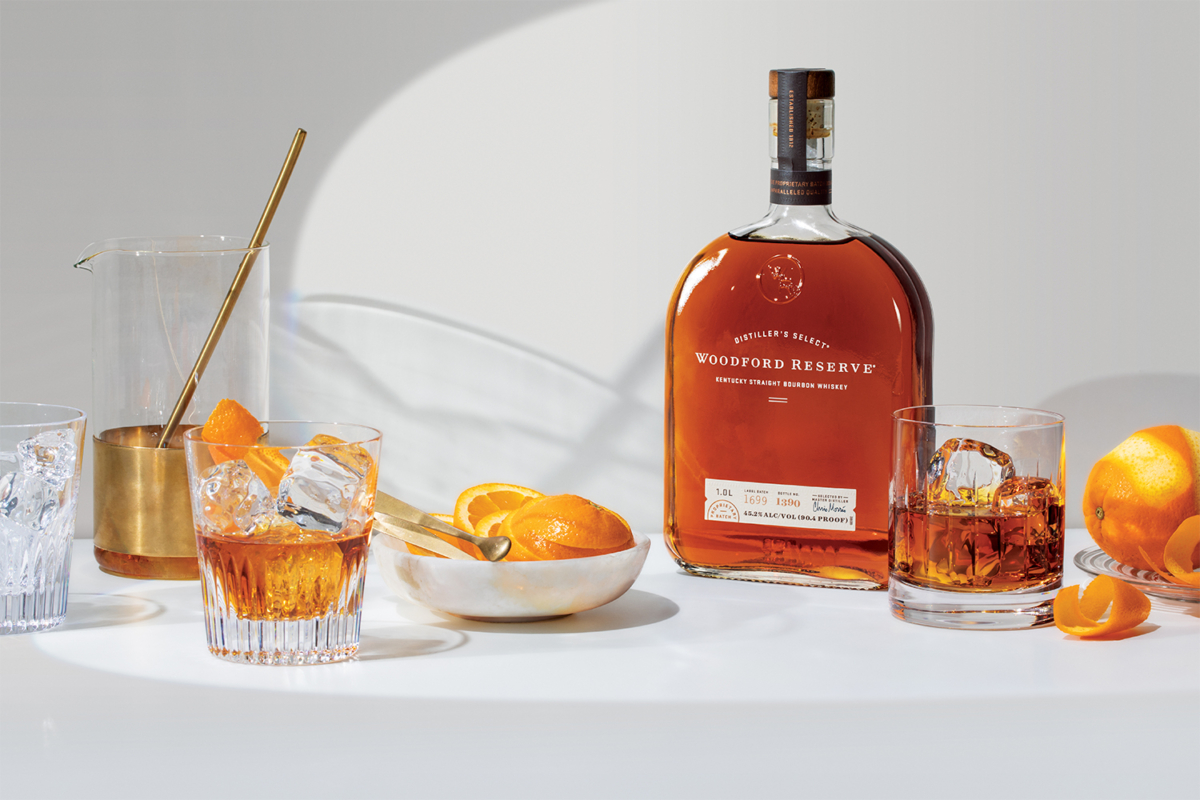 Woodford Reserve Whiskey bottle with oranges and cocktail