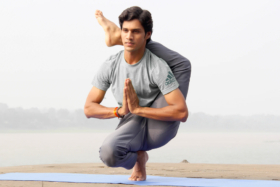 A man doing yoga on a yoga mat