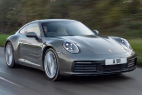 Three quarters Porsche 911 Carrera front on a road