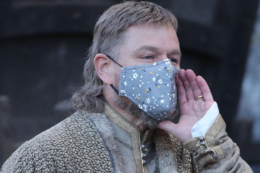 Matt Damon with mullet wearing a mask