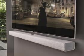 Harman Kardon Multibeam 700 mounted under a TV on wall
