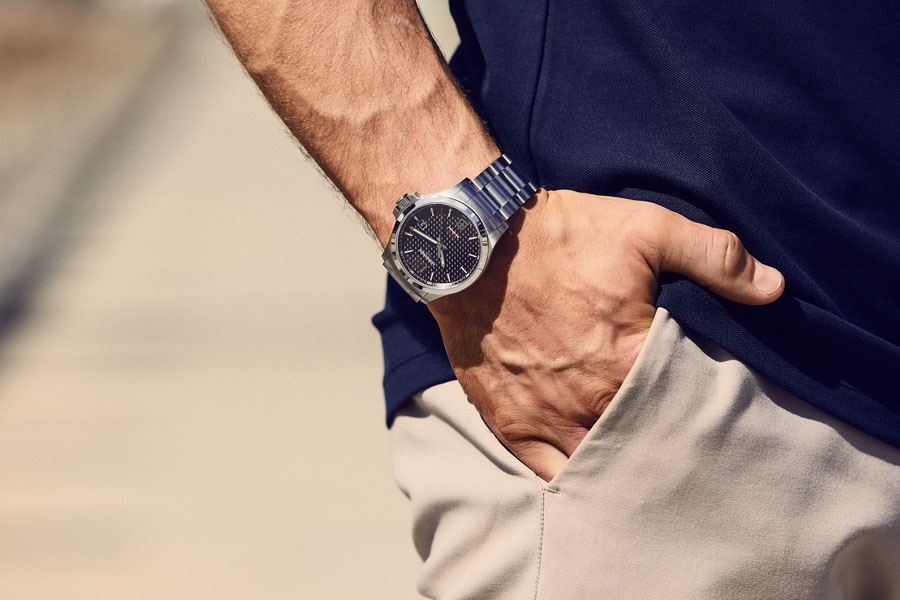 Longines Conquest V.H.P. watch on a hand in pocket