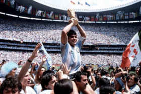 Maradona being carried on shoulder with FIFA trophy