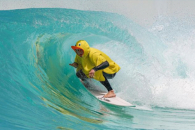 A man surfing in a rubber duck jacket