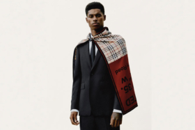 Marcus Rashford in a Burberry suite with a cape