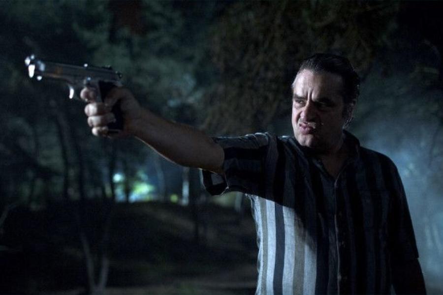Frank Lammers from Netflix Undercover: Season 2 holding a gun