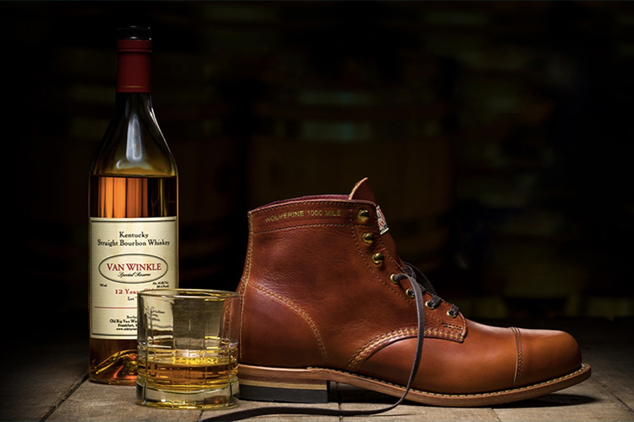 Wolverine Men's Old Rip X 1,000 Mile Cap-Toe Boot and a Van Winkle whisky bottle