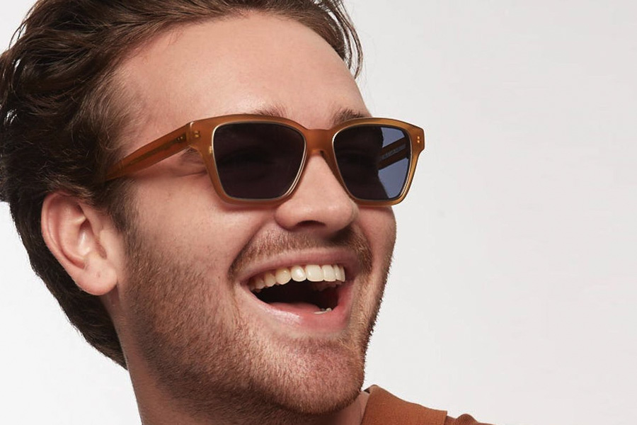A man wearing Bailey Nelson Reverso Halo sunglasses