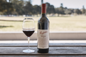 A Penfolds Grange bottle of wine and a wine glass