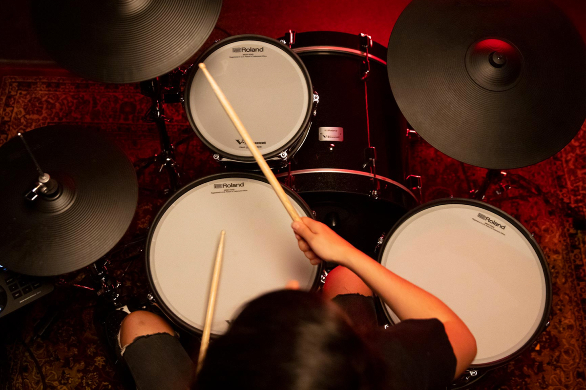 Top view of a drummer playing Roland drums