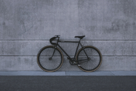 A bicycle standing against a wall