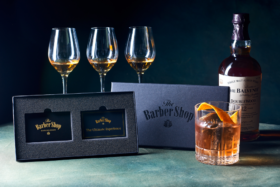 Balvenie whiskey bottle and glasses with The Barber Shop ultimate experience box