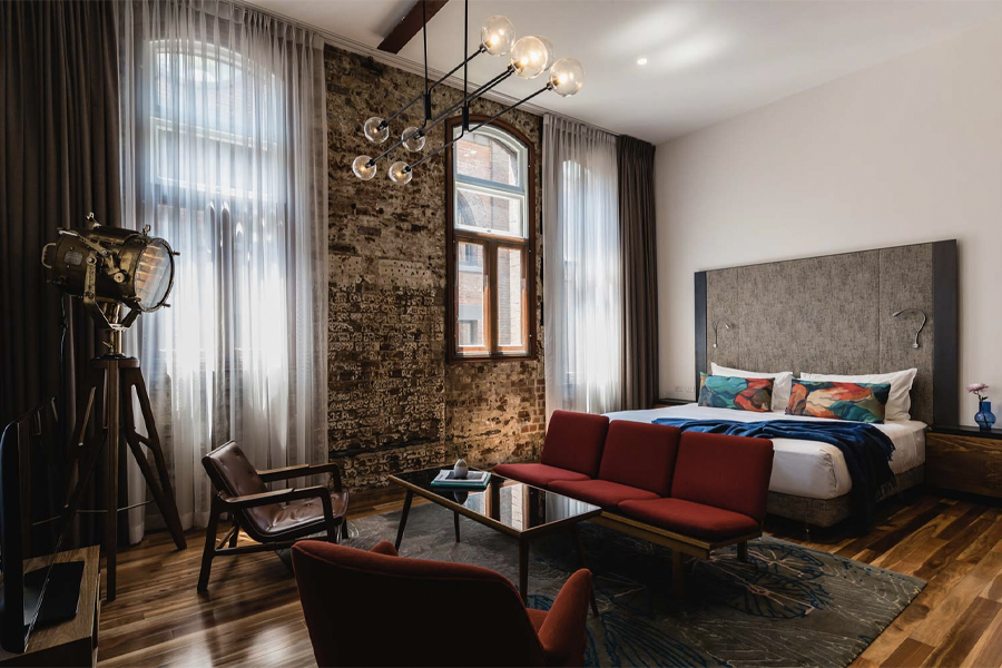 A bedroom of The Old Care hotel