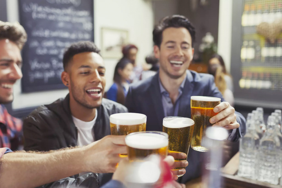 Men toasting with beer glasses