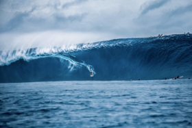 A surfer riding a big wave