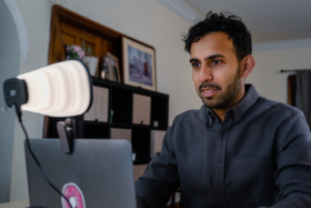 A man using a laptop with a Zumy