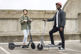 Man and a woman on electric scooters