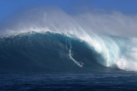 Nathan Florence gets a huge warm-up wave at Jaws earlier in the week