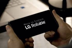 A pair of hand holding LG Rollable phone