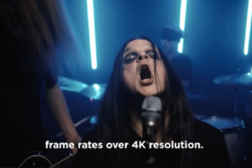 """Caption saying. """"Frame rates over 4K resolution"""" with a metal singer with his mouth open in front of a mic"""