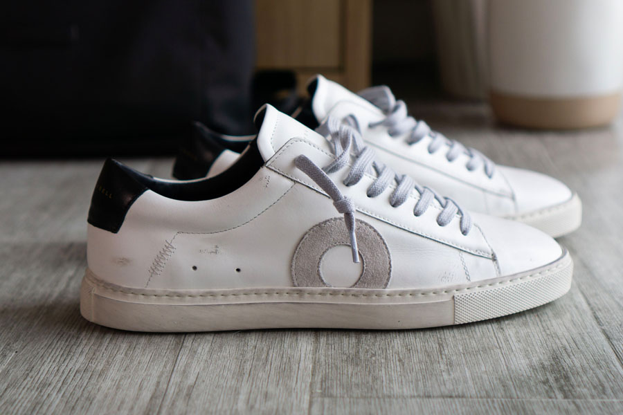 A pair of white Oliver Cabell Distresses shoes