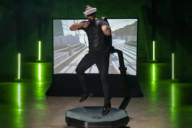 A man playing on Virtuix Omni One At-Home VR Treadmill