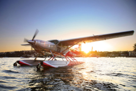 A seaplane on water at sunset