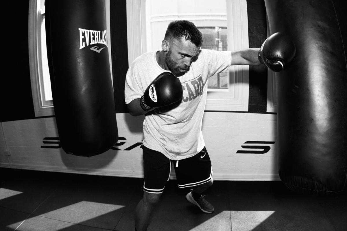 A boxer punching a punching bad