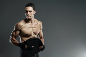A man holding a heavy workout weight