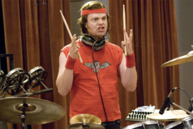 Rainn Wilson as a drummer from Whiplash