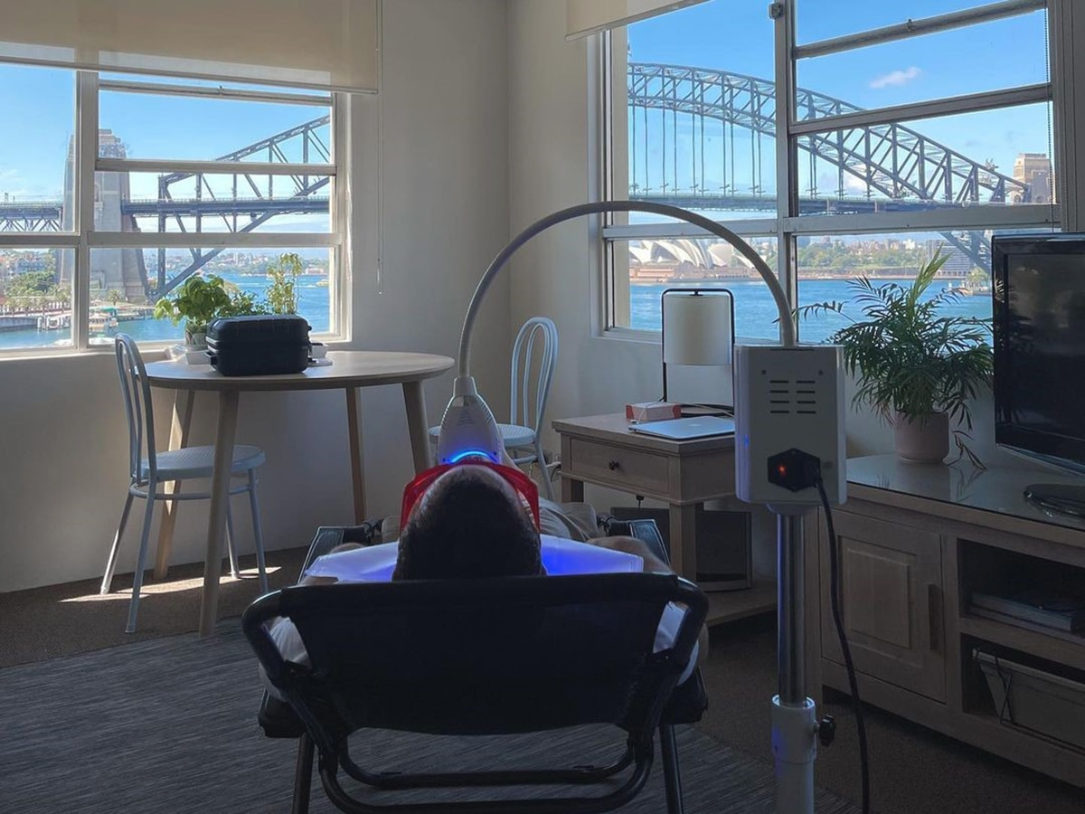 patient lying on chair during procedure of teeth whitening at whitening by b clinic