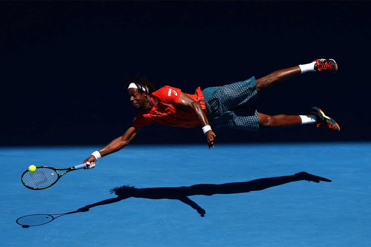 Gael Monfils dives at Australian Open 2016