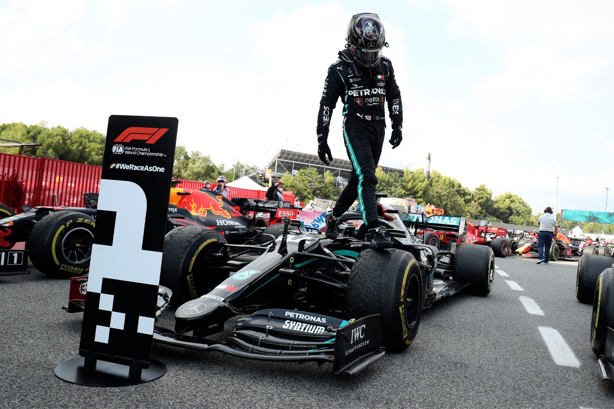 Lewis Hamilton standing on Petronas Car