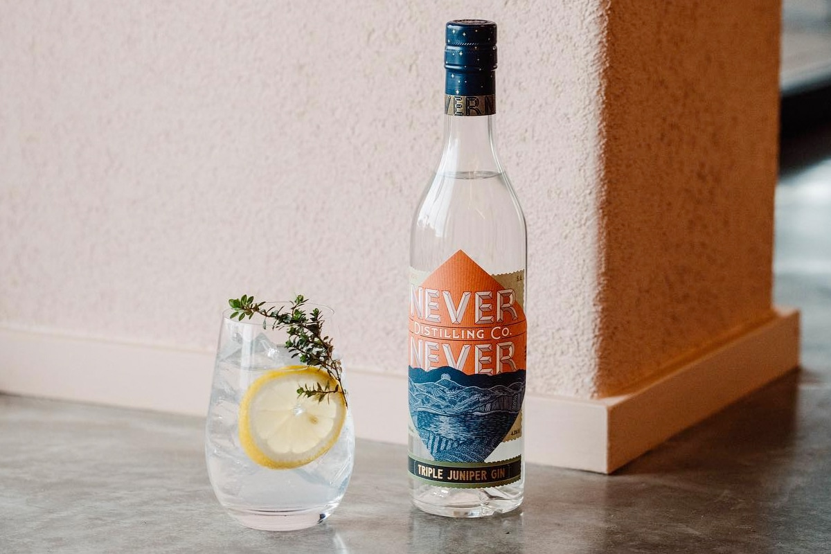 Bottle of Never Never next to a glass