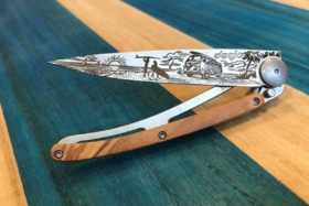A Deejo knife with wood handle