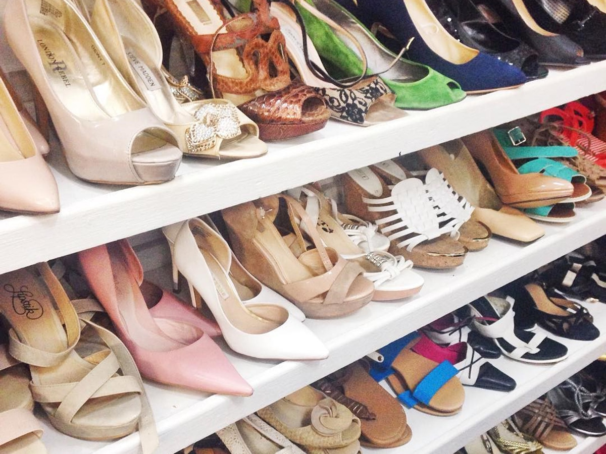 second hand shoes on rack at st veronicas thrift shop west end