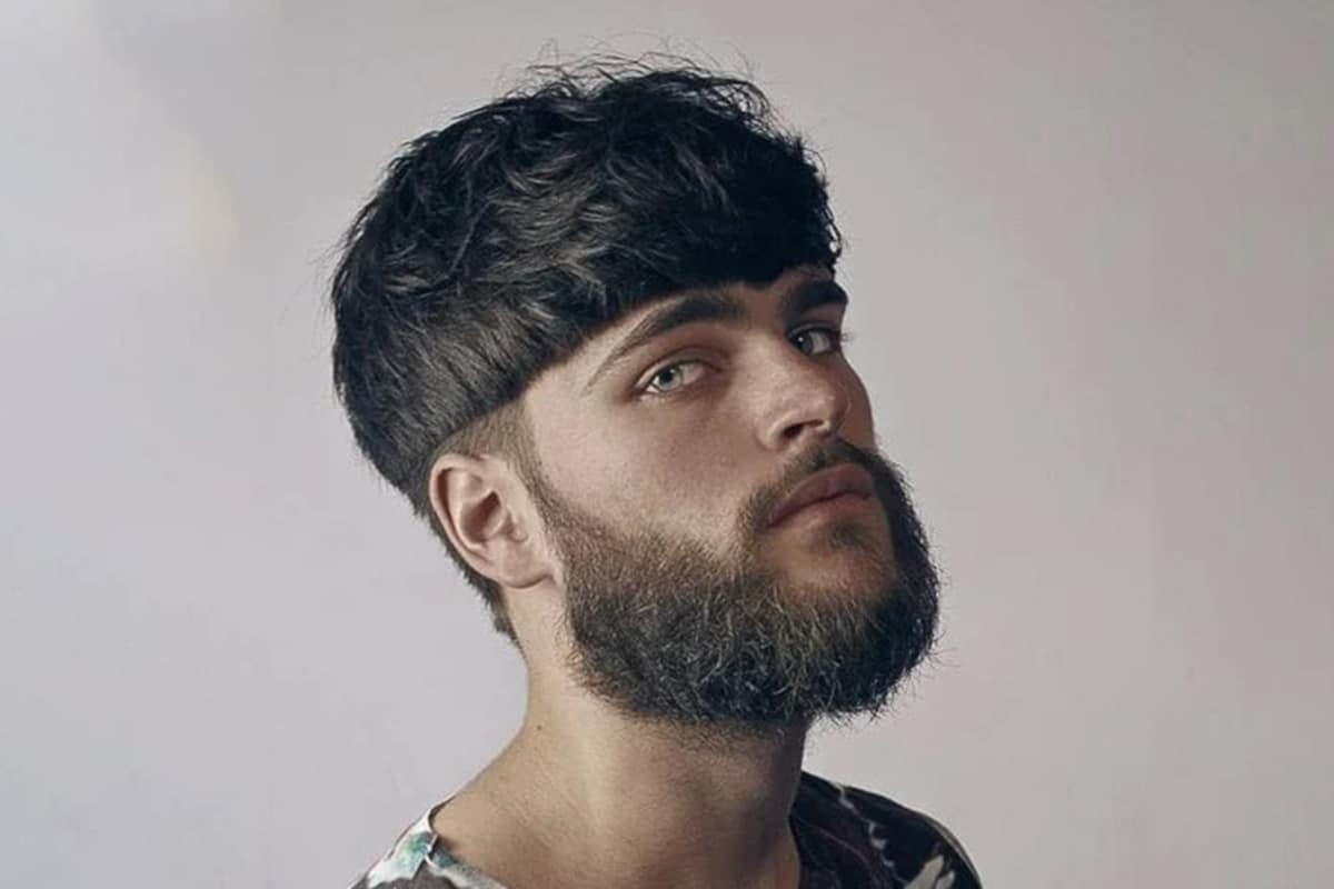 men's bowl cut with a low fade hairstyle