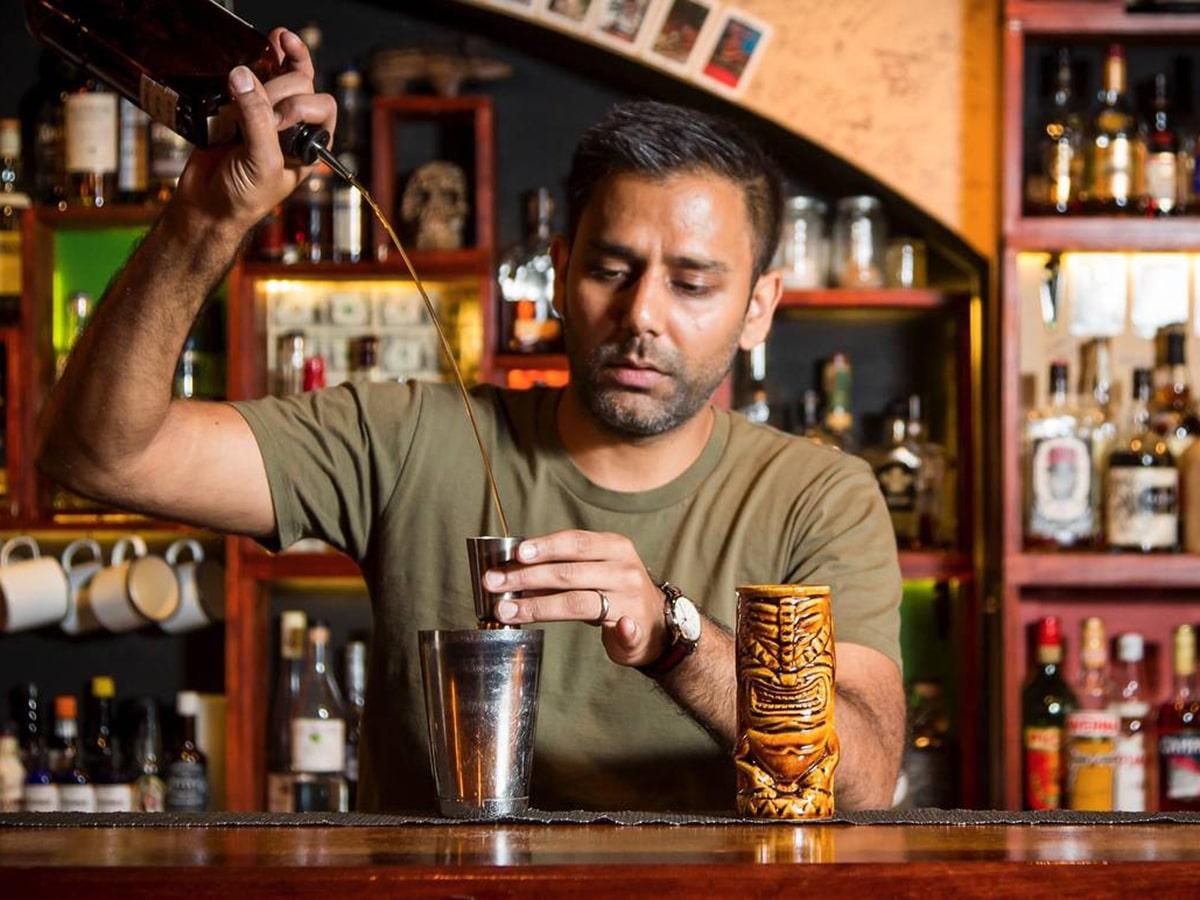 papa gedes bartender serving drinks