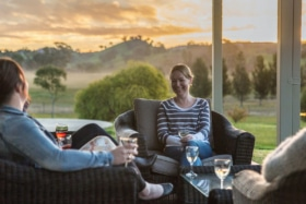 Group of people drinking wine outdoors