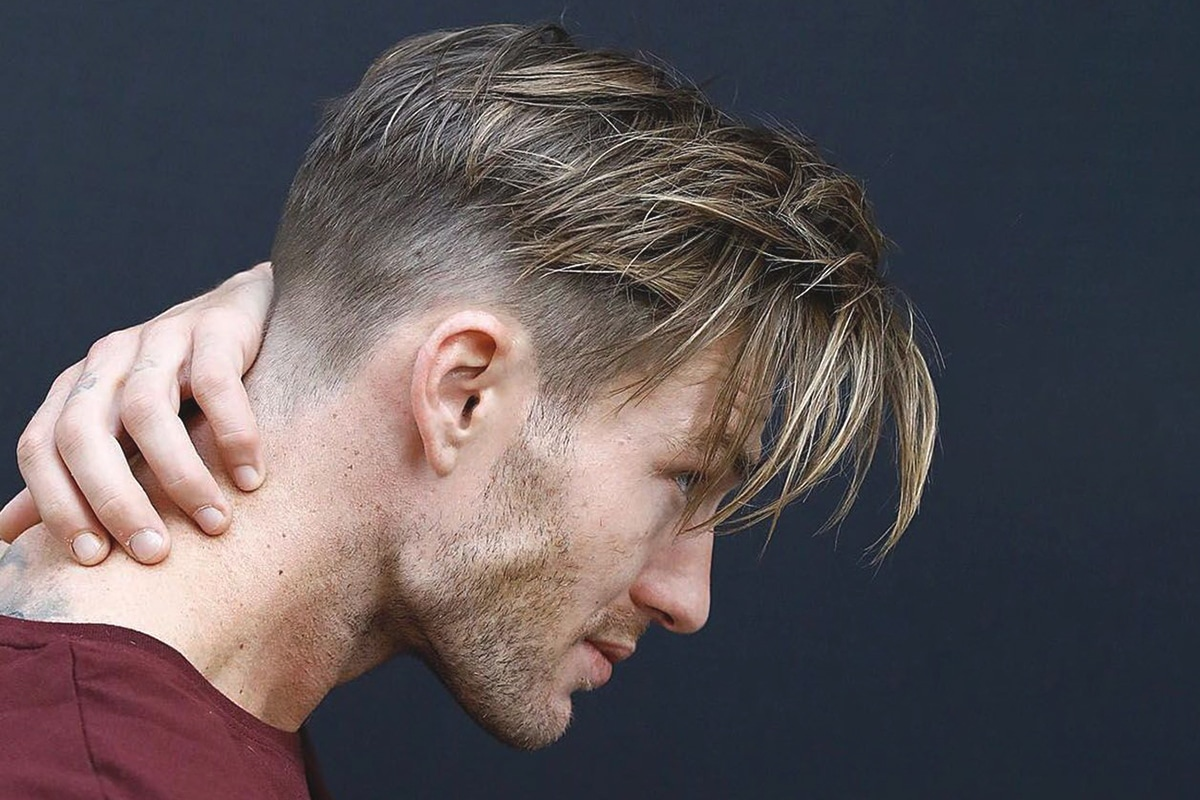 men's middle part hairstyle with faded sides