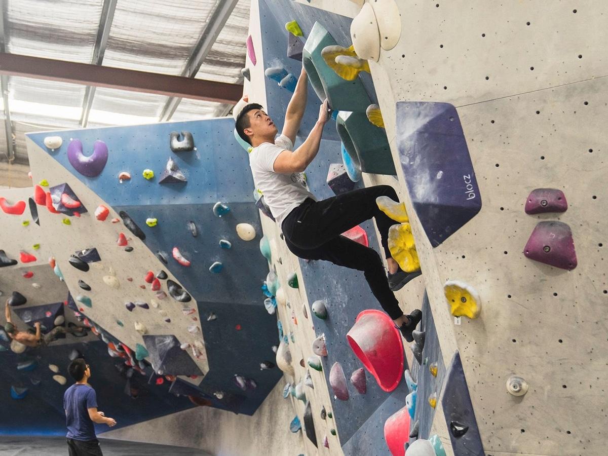 man climbing wall at 9 degrees