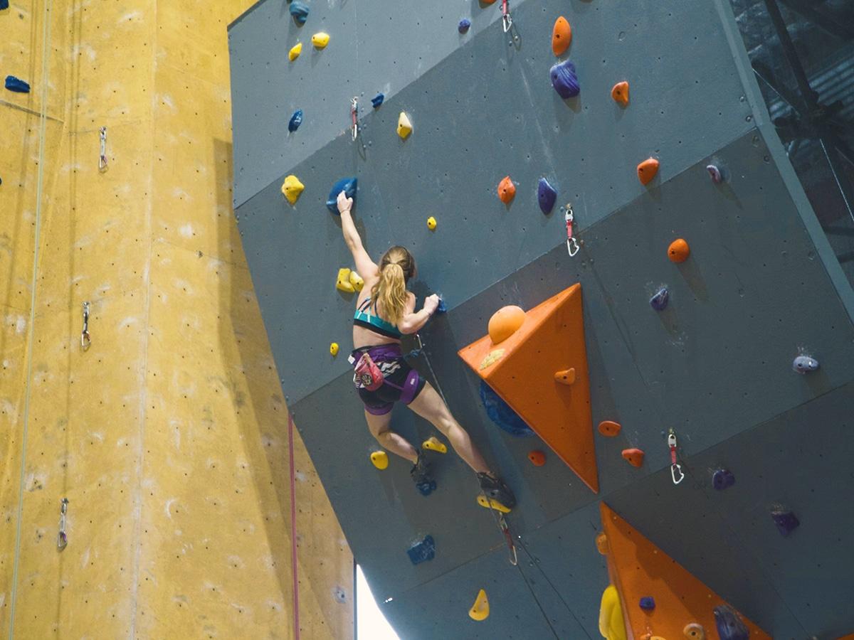 woman on climbing wall at edge rock climbing centre