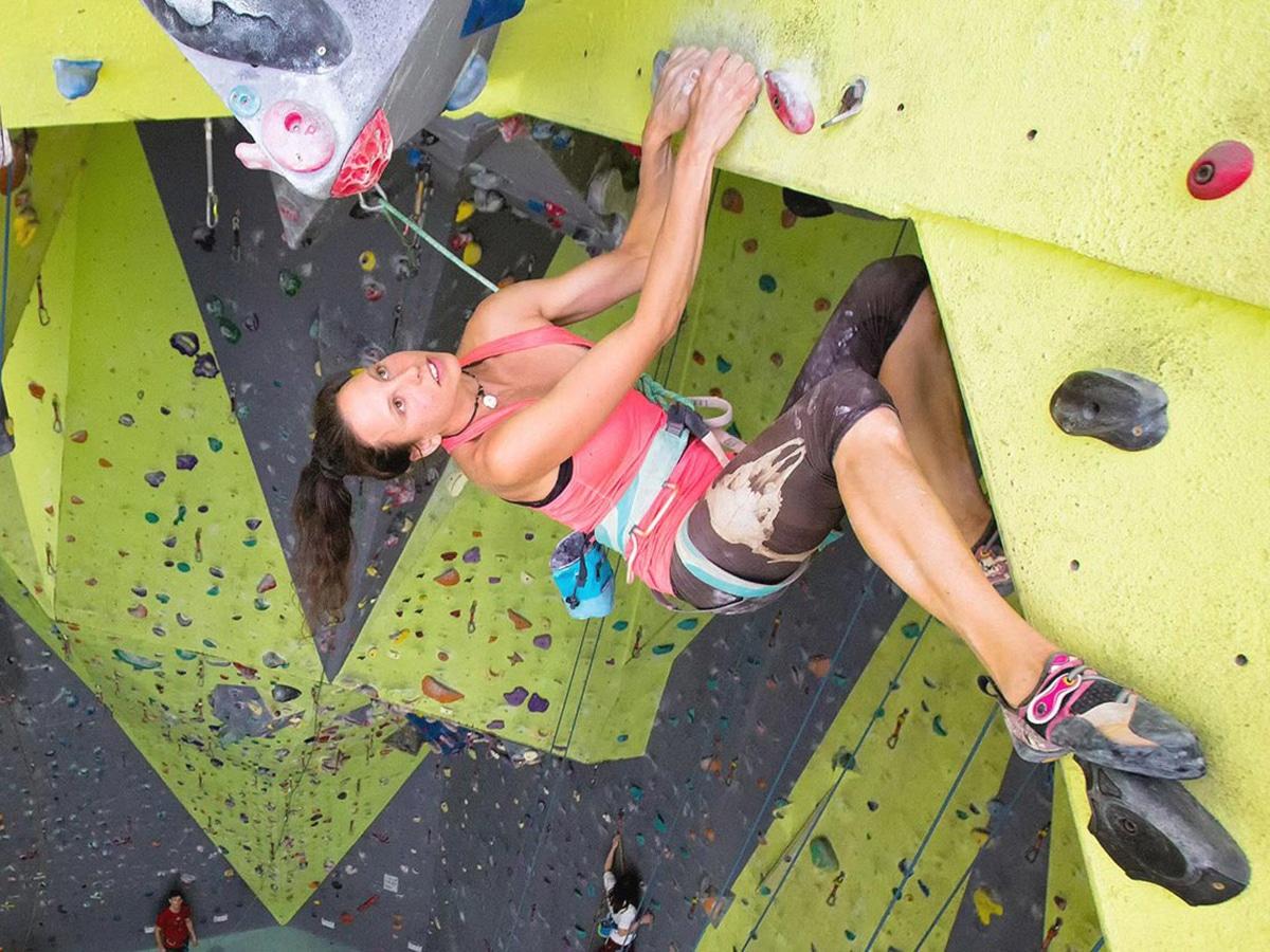 girl climbing wall at st peters indoor climbing gym