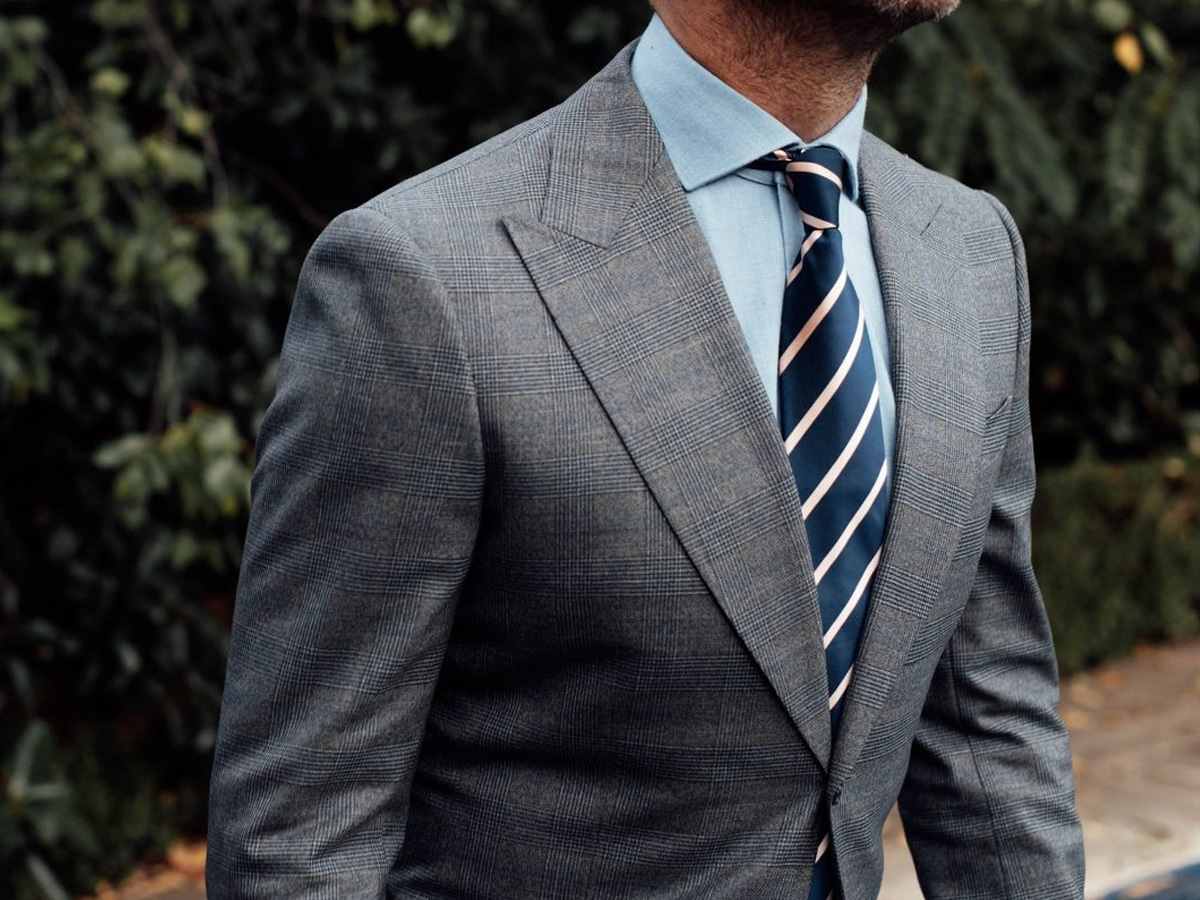 man in Deluca tailors suit and tie