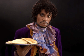 """Dave Chapelle """"The Prince"""" holding a plat full of pancakes"""