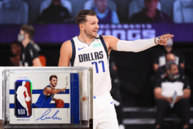 The Luka Doncic rookie card in corner of Luka's photo from basketball court