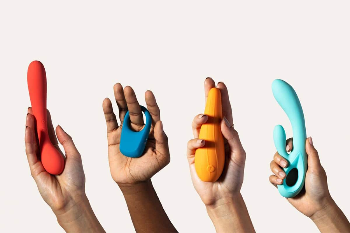 Four hands holding sex toys