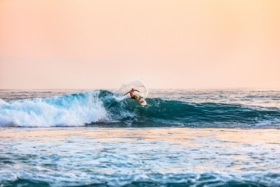man surfing on a large wave